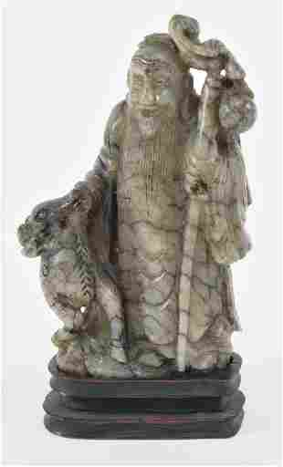 Jade carving. China. 19th century. Stone of a grey