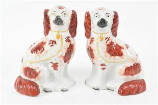 Pair Staffordshire porcelain red and white spaniel
