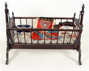 Victorian suspended basinet together with a group of