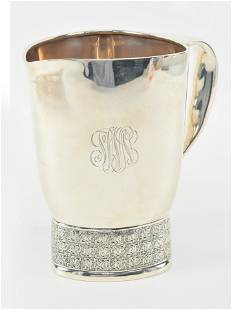 Tiffany & Co. Makers sterling silver water pitcher. 3.5