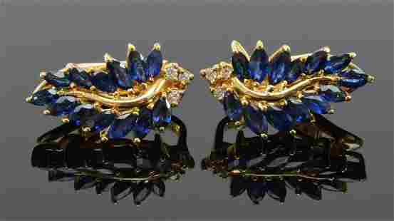 Pair of 18K gold sapphire and diamond foliage form ear