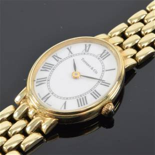 Ladies 14K gold wristwatch, oval dial signed Tiffany &