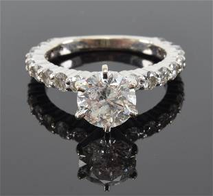 Approximate 1.5 CT round diamond engagement ring. Set