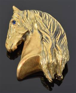 18K gold horse head pin, sapphire eye and fully