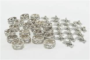 Set of 20 sterling silver napkin rings with 24 silver