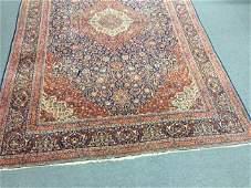 "Semi-Antique Persian Kashan carpet. 16'8"" x 10'10""."