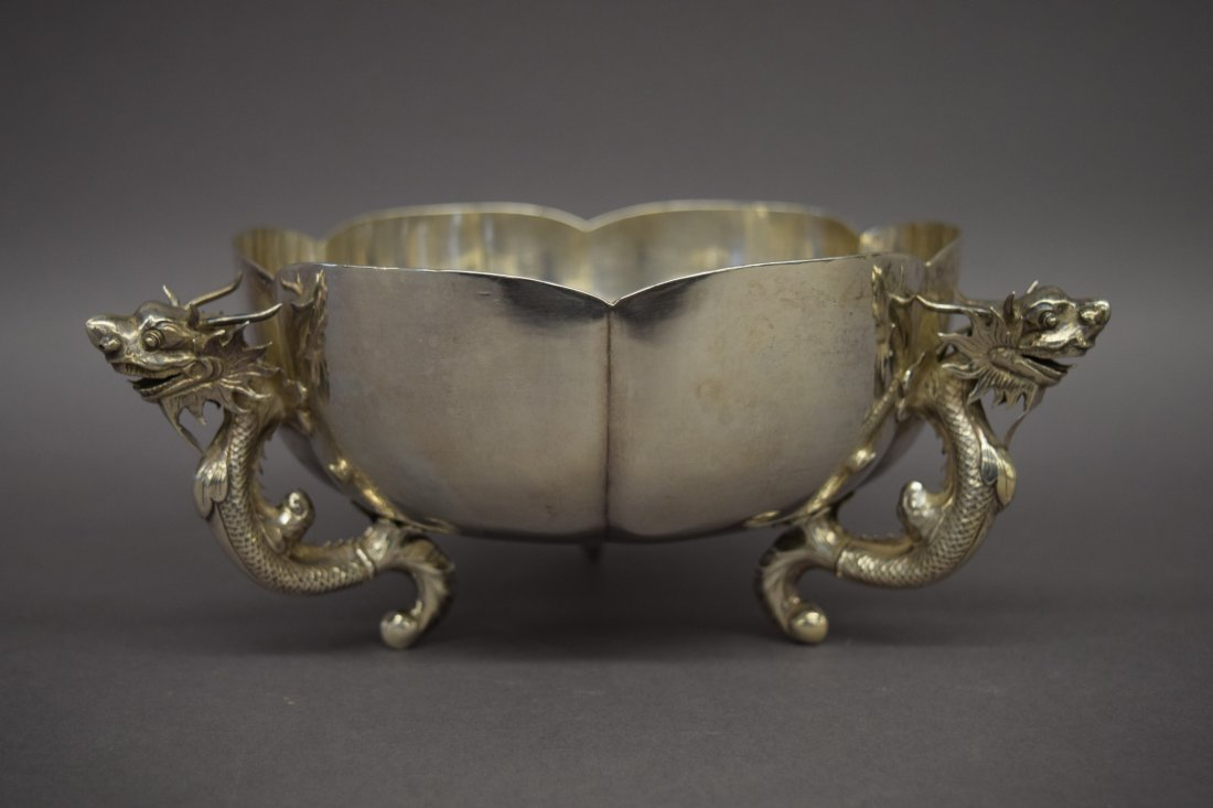 Chinese Export silver bowl with three dragon supports.