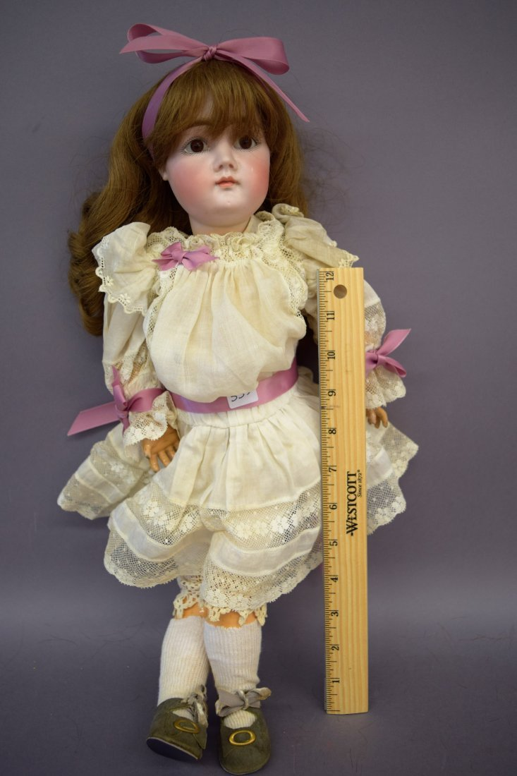Antique Bisque head doll. Marked H 10 C. Closed mouth.