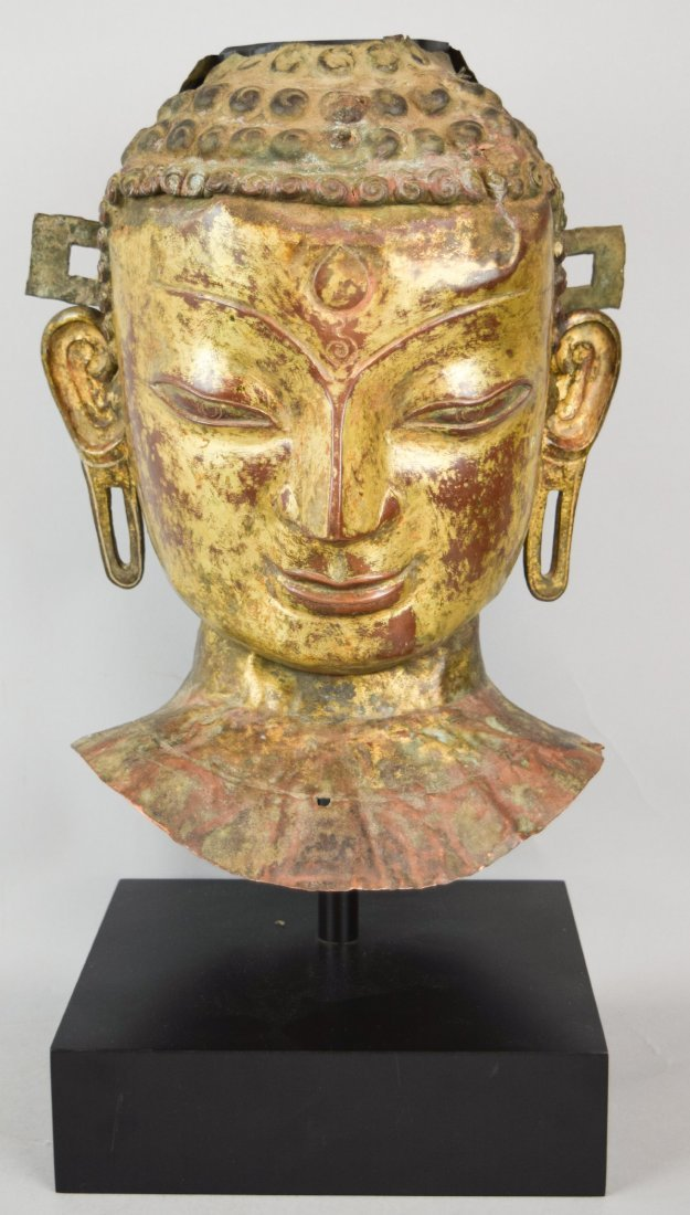 Repousse copper head of the Buddha. Tibet. 18th cent.