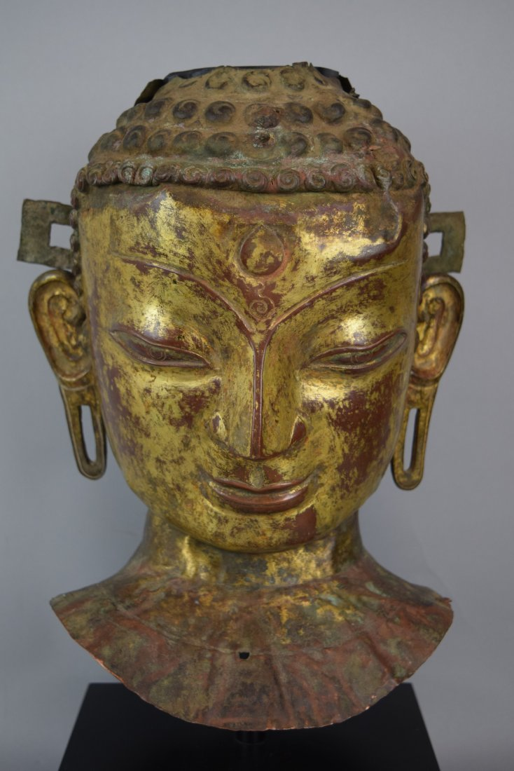 Repousse copper head of the Buddha. Tibet. 18th cent. - 2