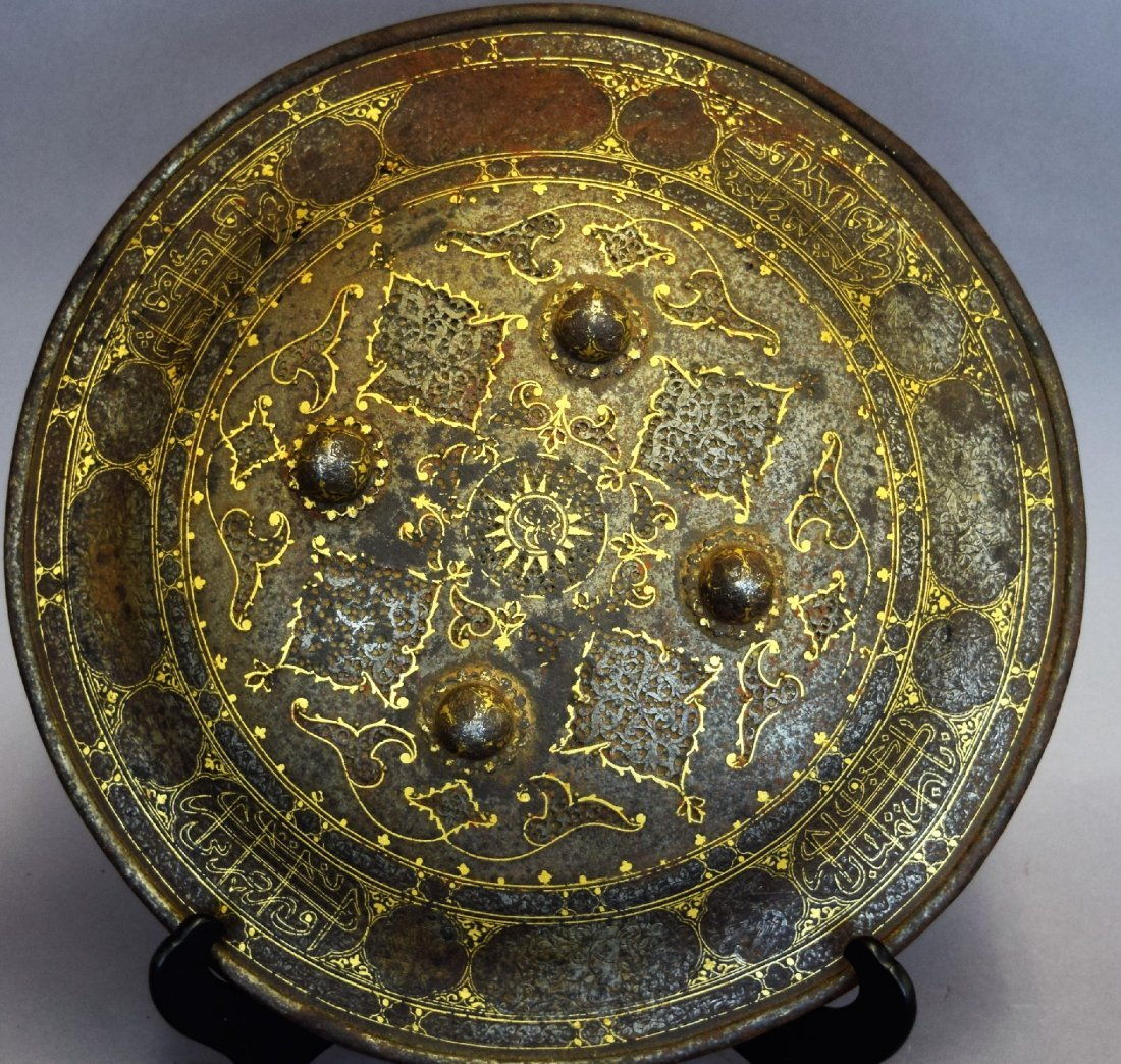 Shield. Persia. 19th century. Steel with gold inlay of
