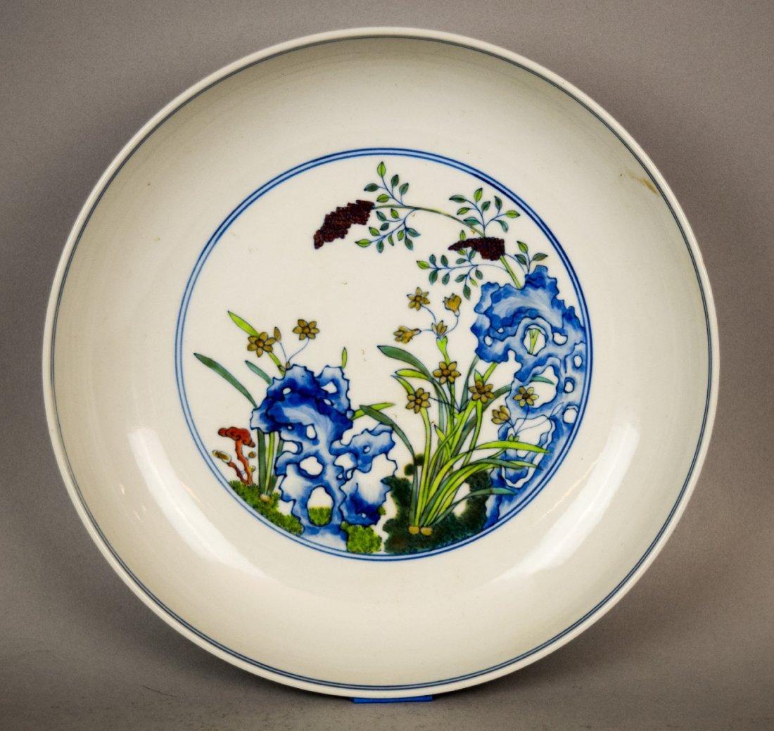Porcelain saucer dish. China. 20th century. Tou Tsai