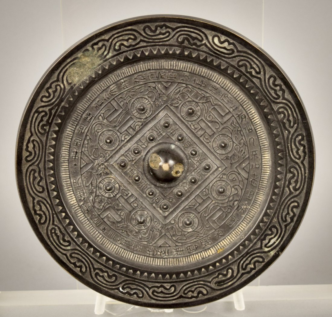 Bronze mirror. Han style TL type with a lengthy