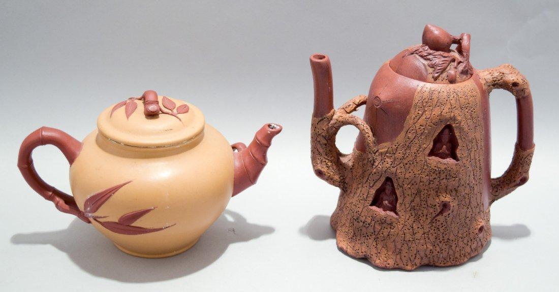 Two stoneware teapots. South China. 20th century. Yi