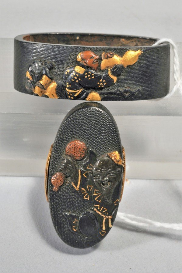Set Fuchi-Kashira, Japan. 18th/19th century. Signed.