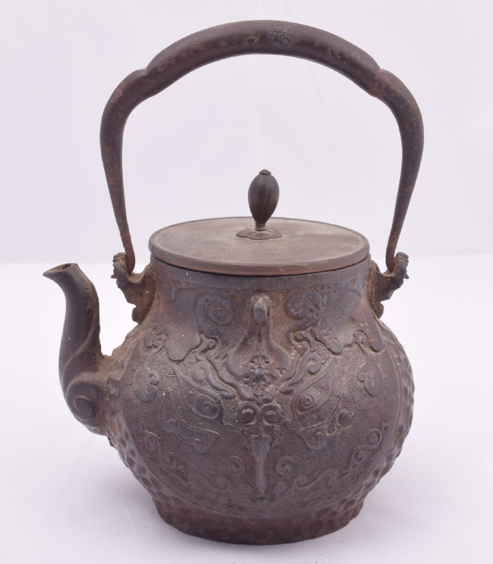 Two cast iron Meiji 19th century Japanese teapots.