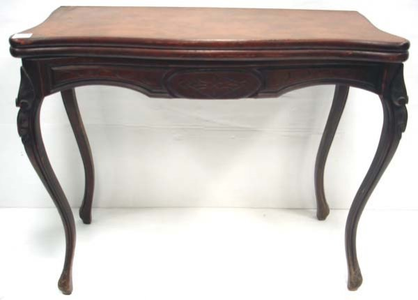 106: CARVED VICTORIAN WALNUT GAME TABLE