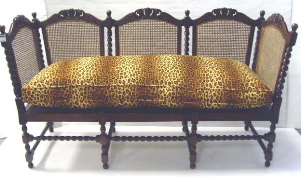 872: VICTORIAN CARVED OAK SETTEE W/CANE PANELS & L
