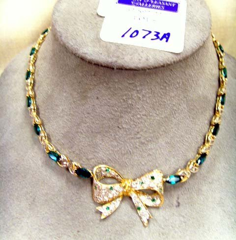 1073A: 14K GOLD & EMERALD BOW NECKLACE