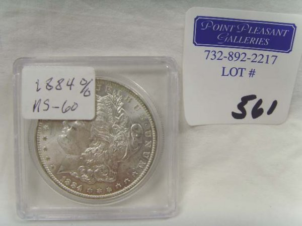 561: 1884 SILVER DOLLAR MS - 60 REPUNCHED MINT MARK
