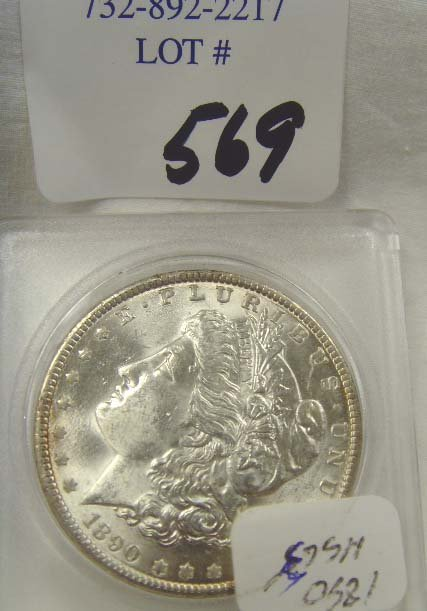 569: 1890 SILVER DOLLAR MS 63