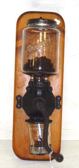 103: EARLY ARCADE WALL MOUNT COFFEE GRINDER - MOUNTED O