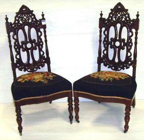 112: PAIR OF VICTORIAN HEAVILY CARVED PARLOR CHAIRS WIT