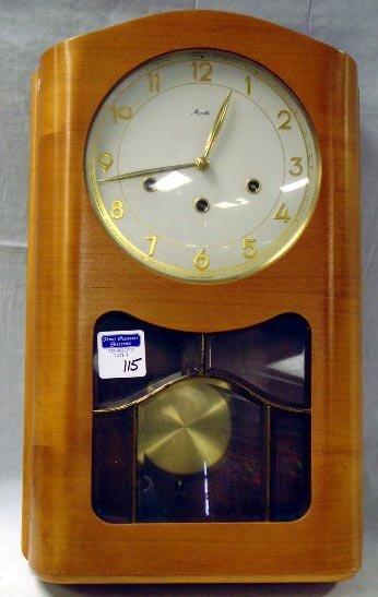 115: MAUTHE MID CENTURY BLOND WOOD WALL CLOCK - 19 X 12