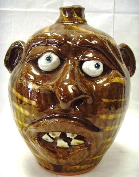 123: MIKE HANNING POTTERY FACE JUG - 10 INCHES