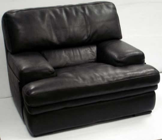 1008: ROCHE BOBOIS DESIGNER LEATHER CHAIR WITH OTTOMAN