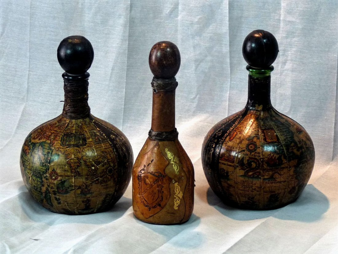 Group of vintage leather covered decanters