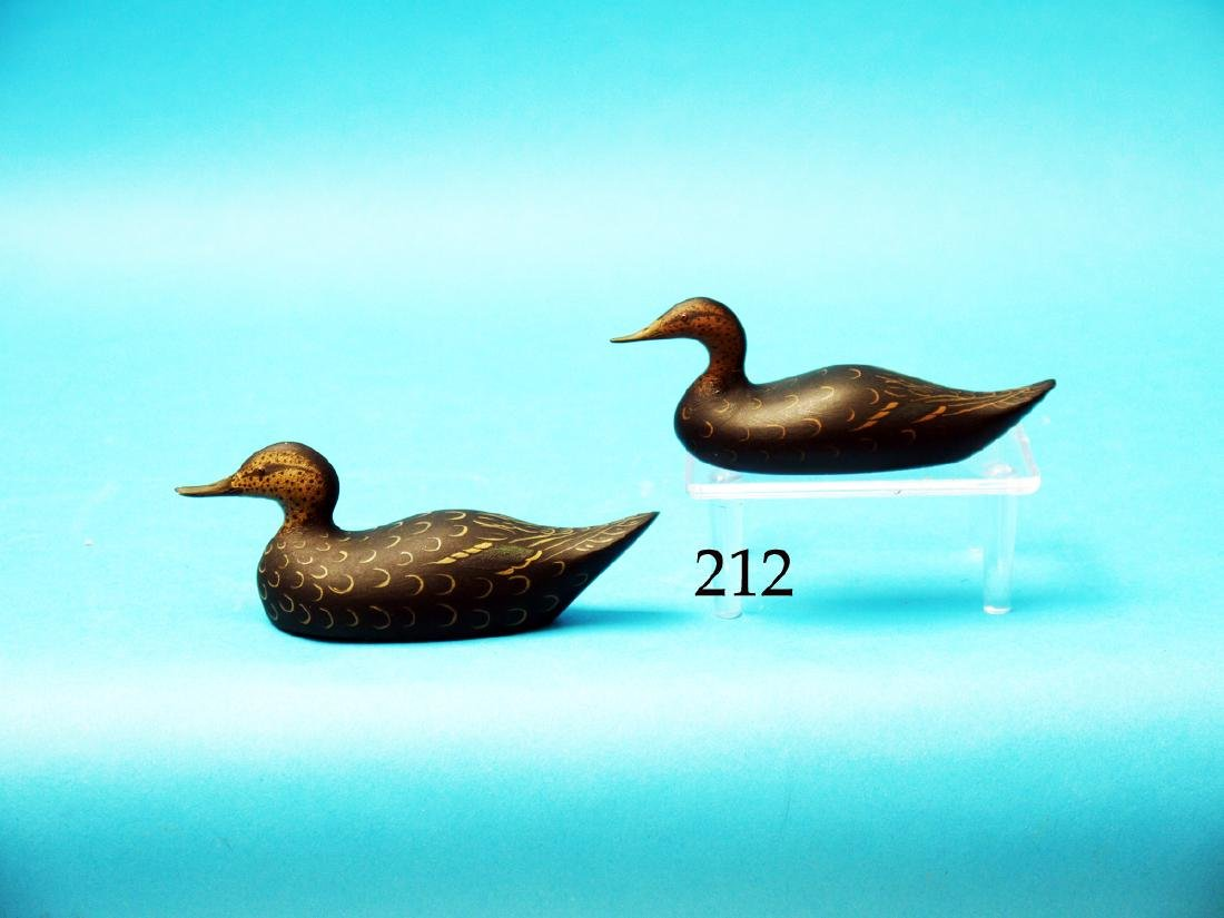 TWO MINIATURE BLACK DUCKS by  Ray Schalk. The first in