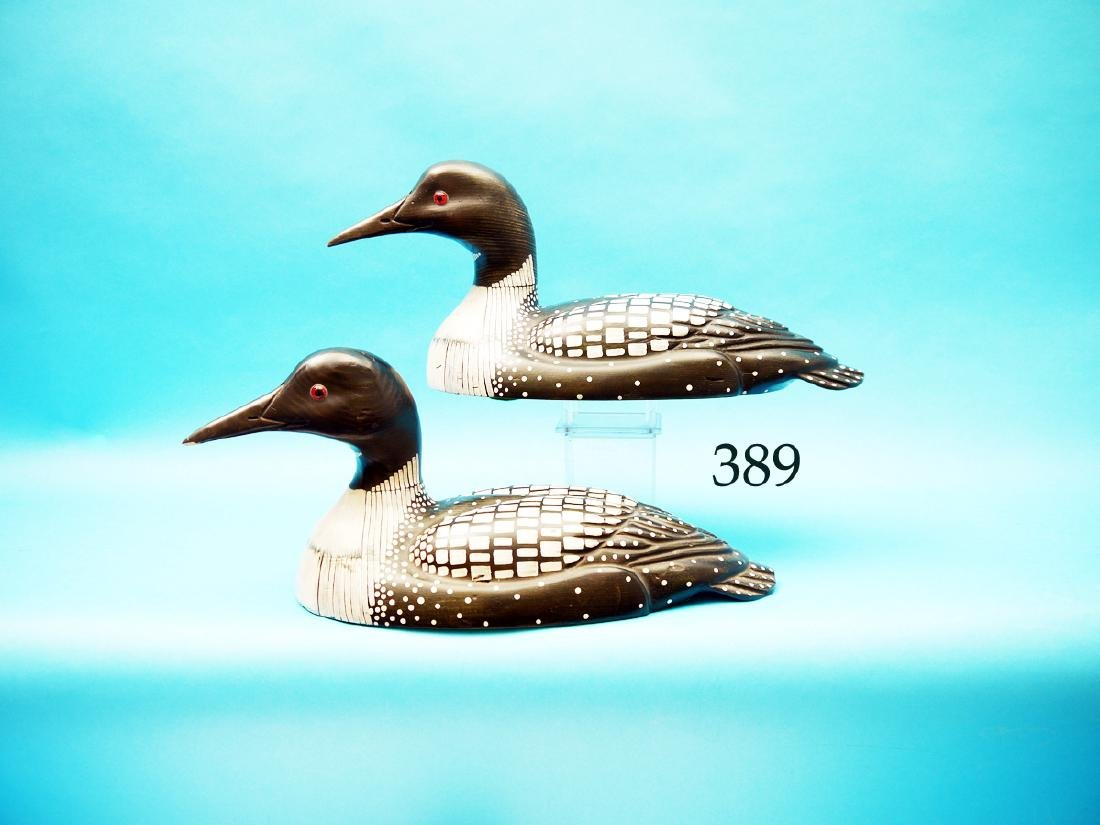 TWO DECORATIVE LOONS by Tom  Taber. Both in excellent