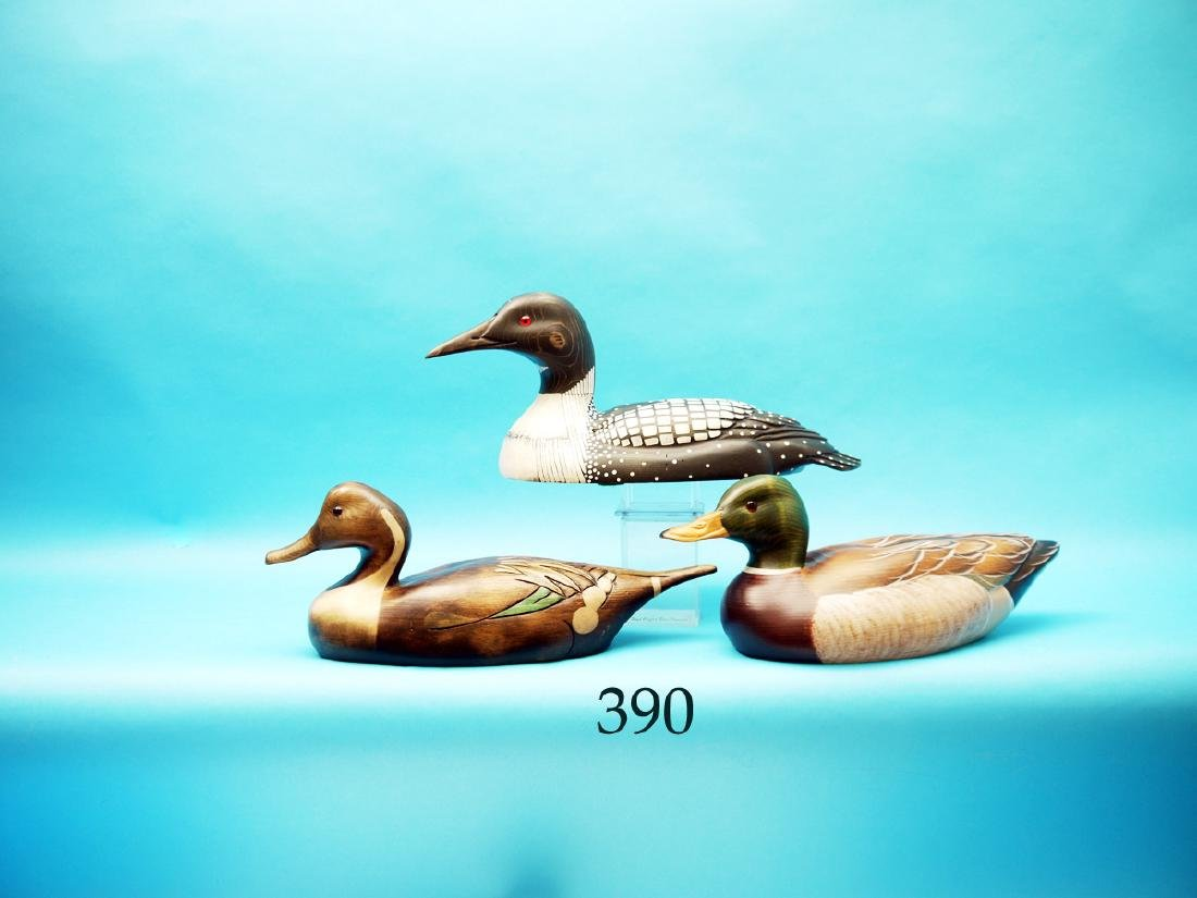 THREE DECORATIVE DECOYS  consisting of a LOON and