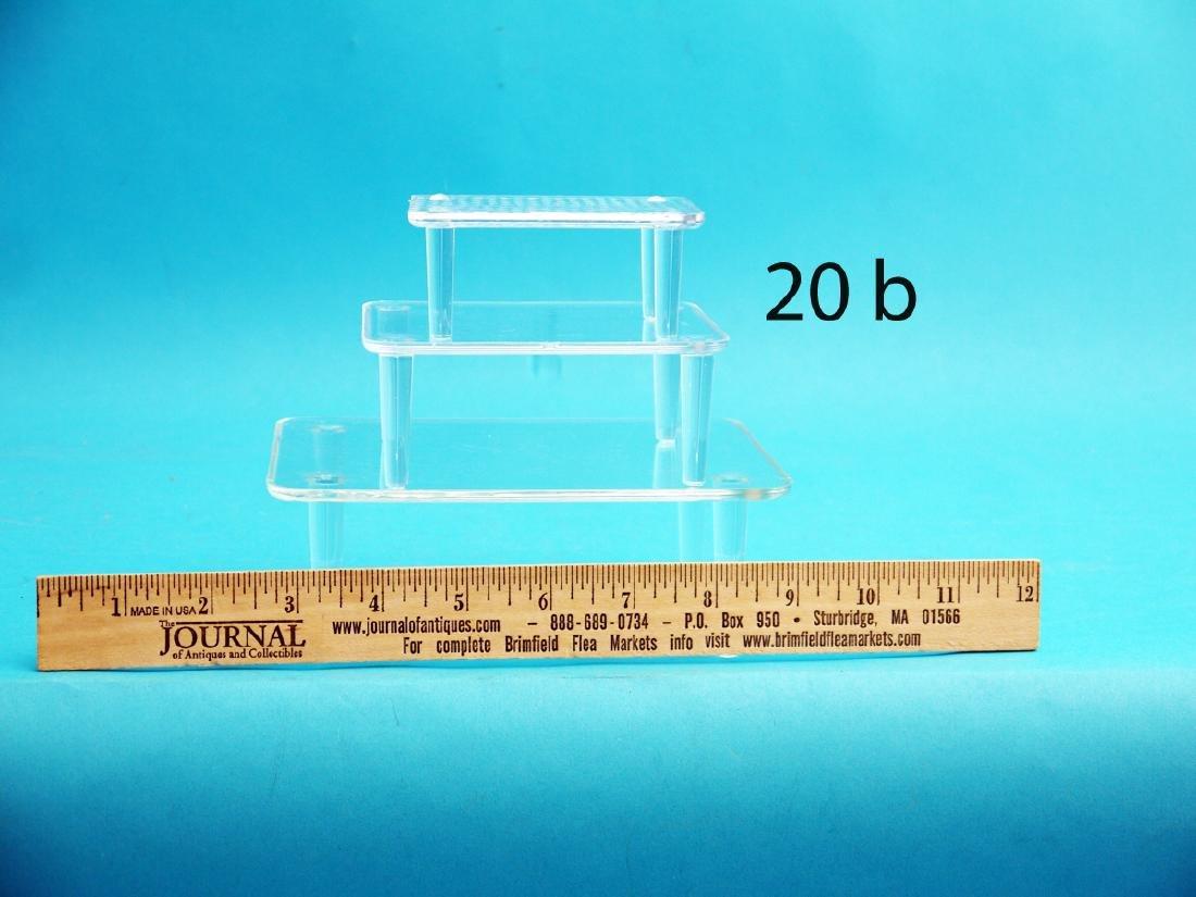 TWENTY-EIGHT DECOY STANDS, acrylic, in various sizes.