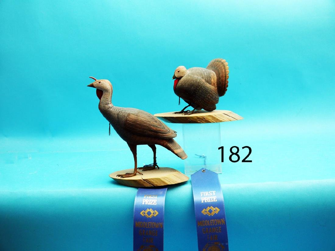 TWO ONE-FIFTH SIZE TOM TURKEY CARVINGS by John Young,