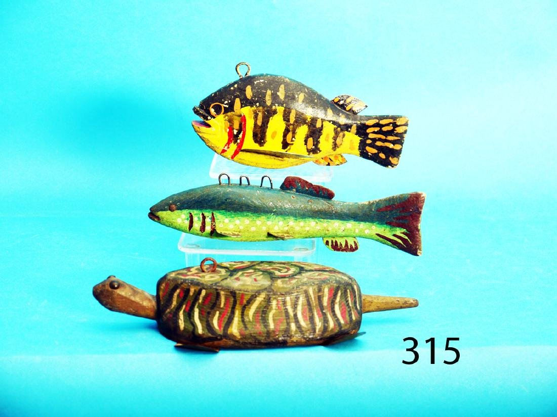 THREE FISHING DECOYS consisting of a whimsical TURTLE,