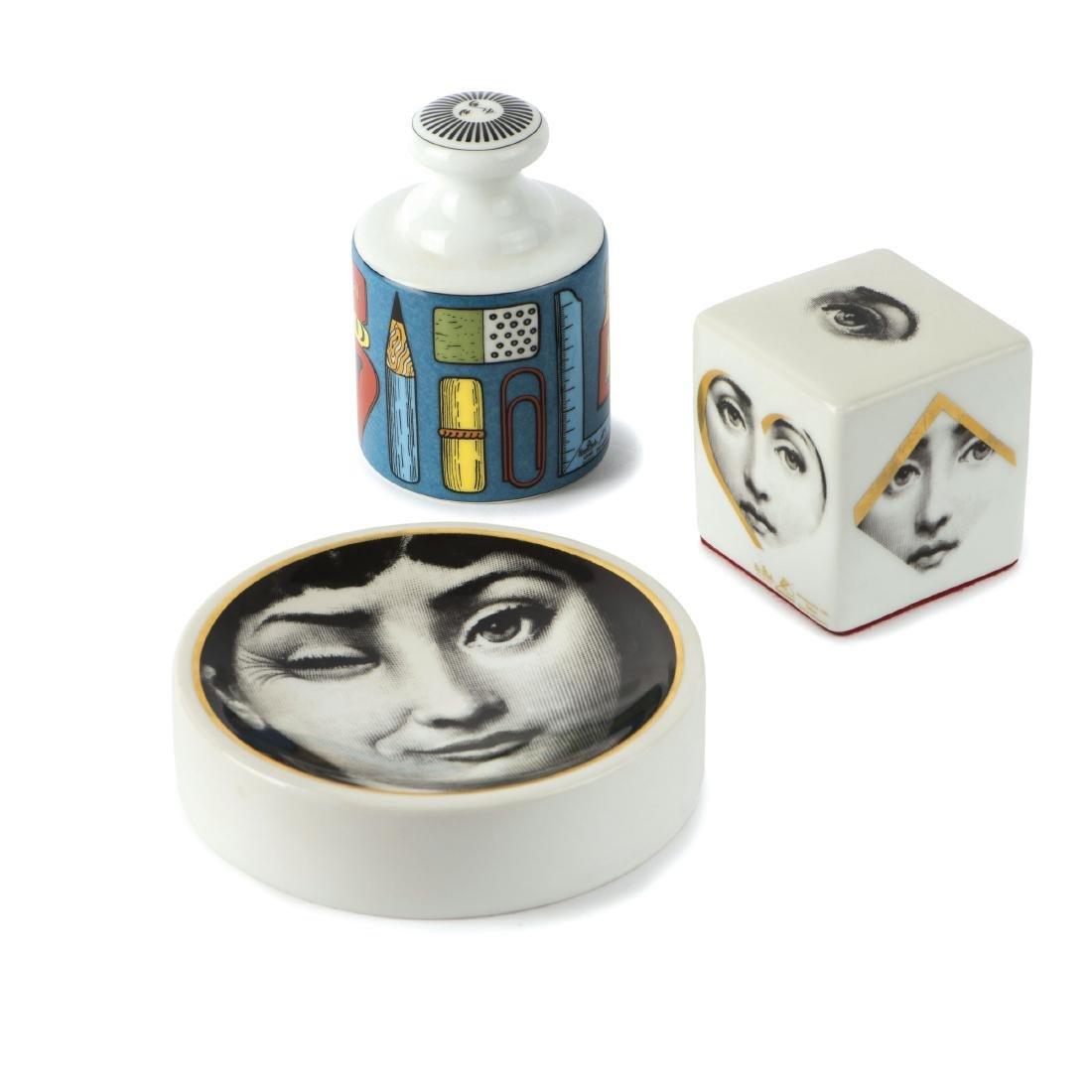 Two 'Strumenti da Disegno' paperweights and 'Tema e