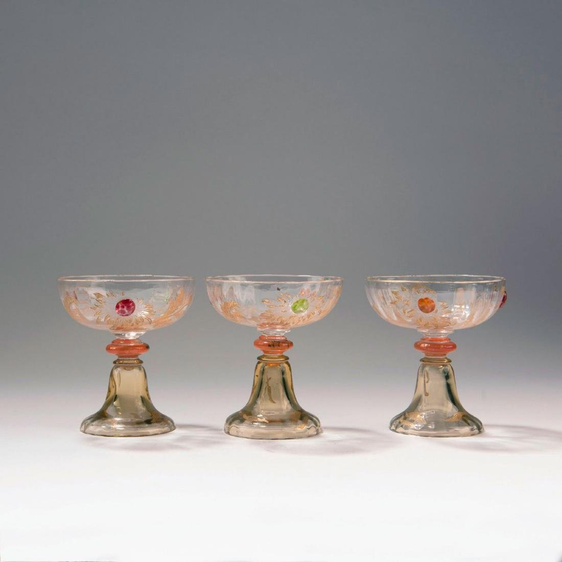 Three champagne glasses from the 'Chrysanthèmes' set,