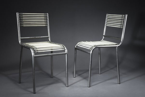 1023: René Herbst. Pair of 'Sandow' chairs. Nickel-plat