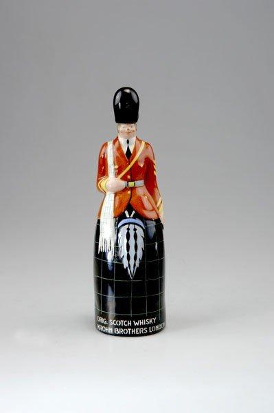 284: Robj, Paris. Whisky flask, circa 1928. H. 30.3 cm.