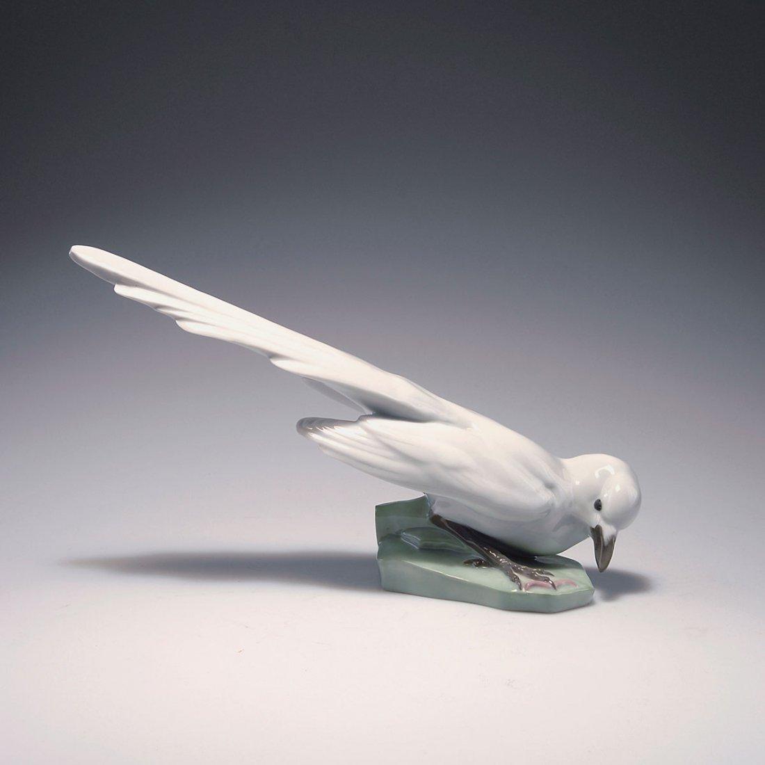 533: Bird with worm, 1920s