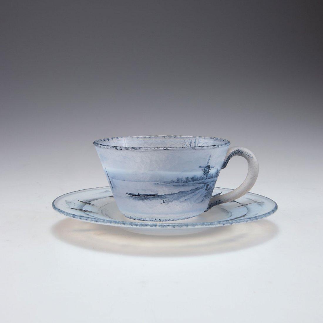 Daum Freres, Nancy. 'Delft' cup and saucer, c1899. H.