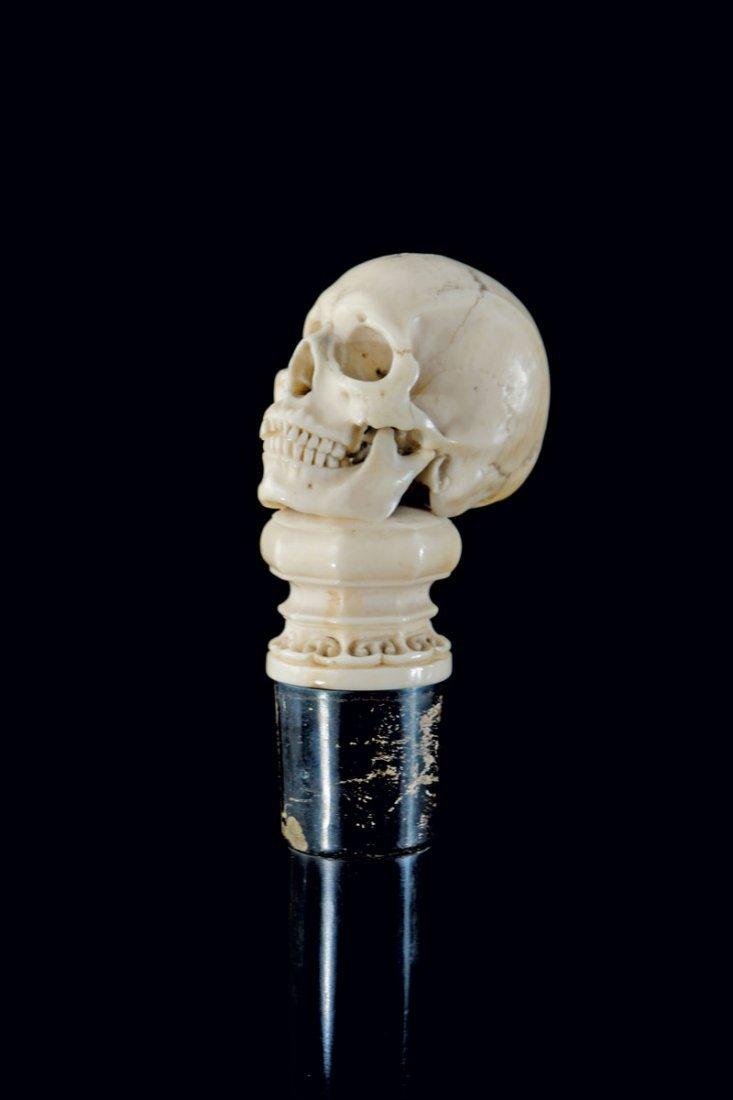 Walking stick. Carved skull on a base. Ivory, silver
