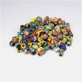 100 small Millefiori glass beads.