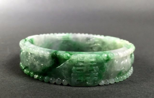 A  Chinese Natural Grade A Jadeite Bangle