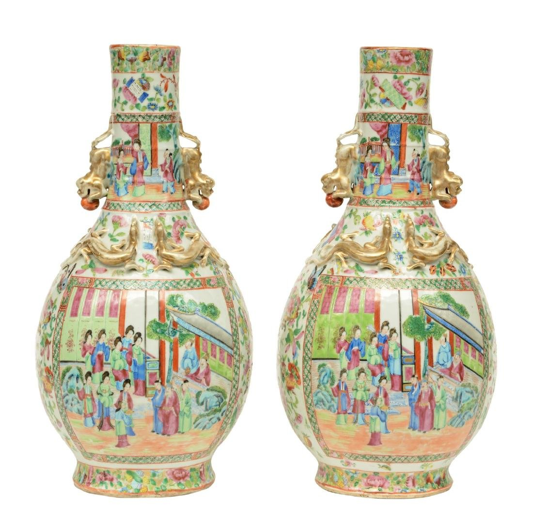 A pair of Chinese bottle vases, famille rose & relief