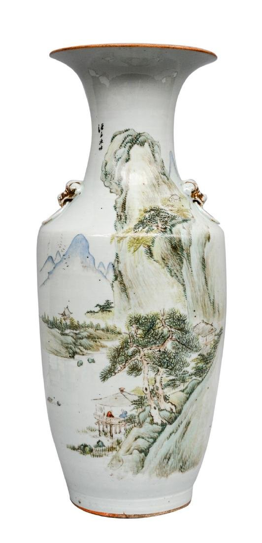 A Chinese polychrome vase, decorated with a mountain