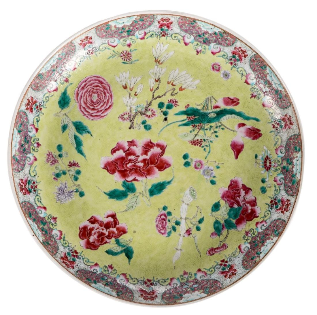A Chinese green ground famille rose plate, decorated