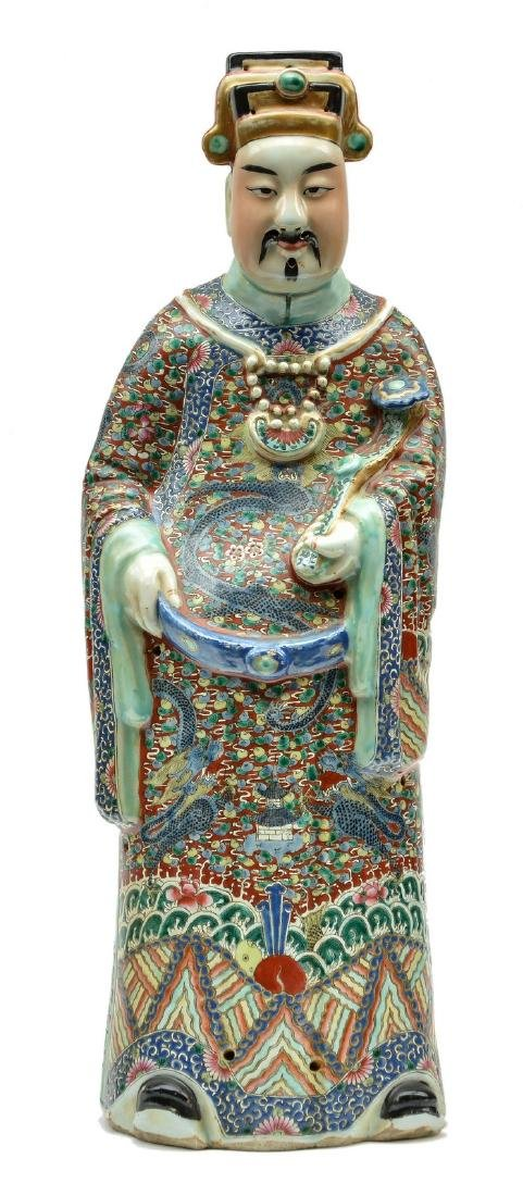 A Chinese polychrome sage, about 1900, marked, H 69 cm